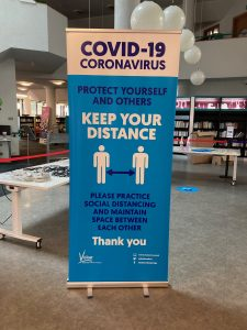 central library - keep your distance banner